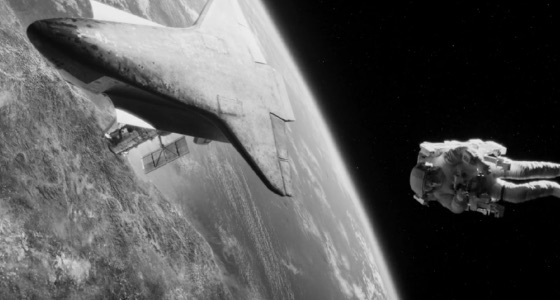 Astonaut and space shuttle orbiting Earth